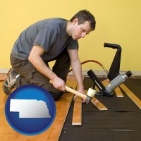 nebraska map icon and a hardwood flooring installer